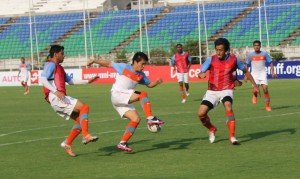 Sunil Chhetri (middle) tries to sidestep past Gouramangi Singh as Gurjinder Kumar (left) presses from behind.