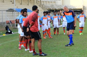 Wim Koevermans gestures to his players during a practice session in Yangon.